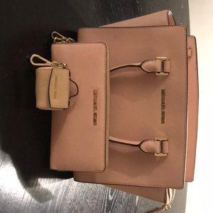 Michael kors cross body hand bag/matching wallet.
